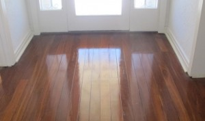 The rich colours of hardwood Jarrah with highly polished surface restored by Profloors