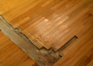 What happens when you rempve a wall, the timber flooring will need restoration. That's what. Call Profloor Australia